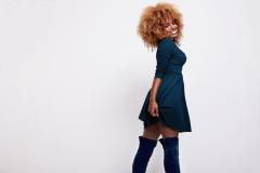 smiling dancing black blonde woman