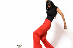 Attractive young african-american girl in red pants.