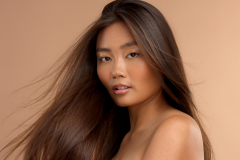 thai asian model with natural makeup on beige background