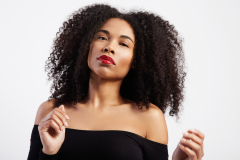 dancing black woman with afro hair in studio shoot