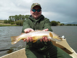 Lewis shows off his catch...a hefty brown trout with a belly full of stone flies.
