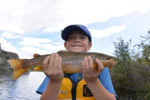 My little buddy with a fine Big Hole River brown that ate a Salmon fly dry.