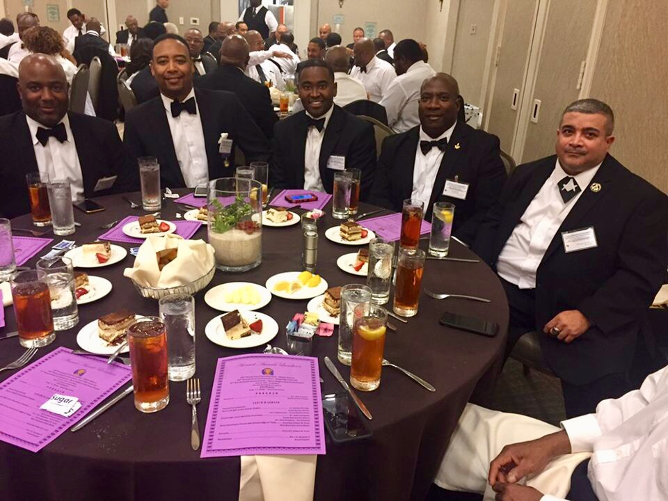 Brothers take time for a photo at the 2018 143rd Grand Communications