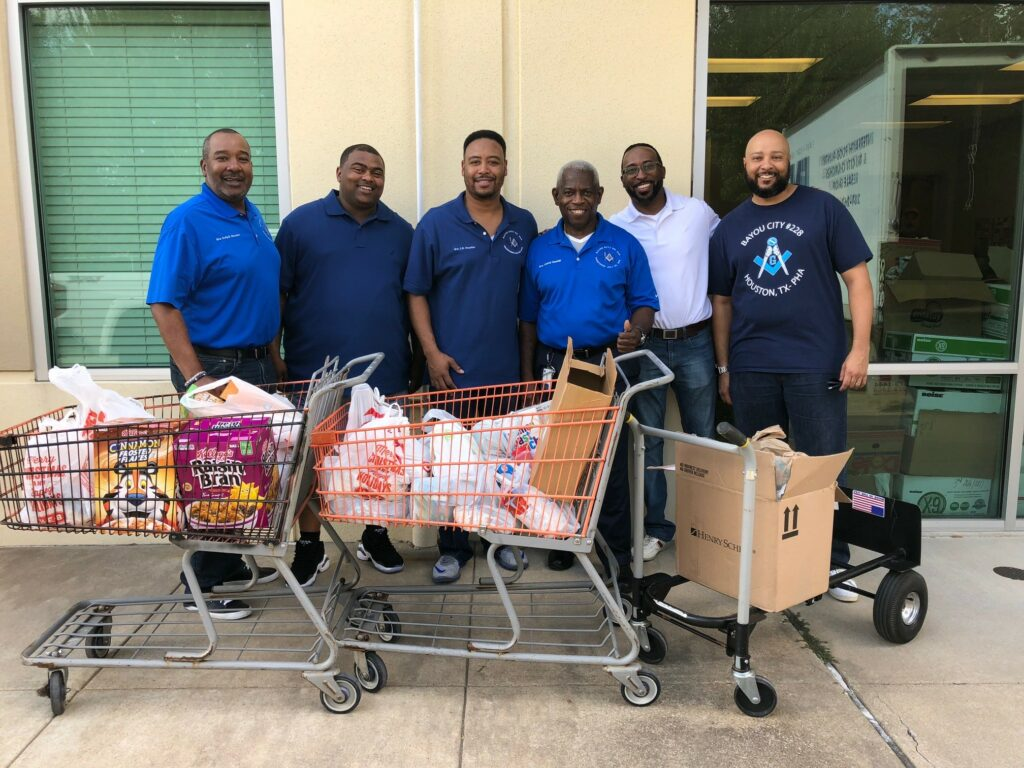 Bros. donating food to the Fort Bend County Food bank