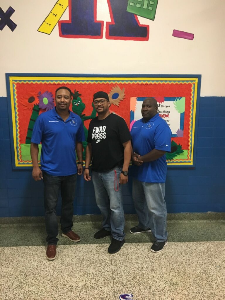 WM Houston,  Principal Collins & Bro. Mike Roberts after 2018 Backpack Donation Kashmere Elementary