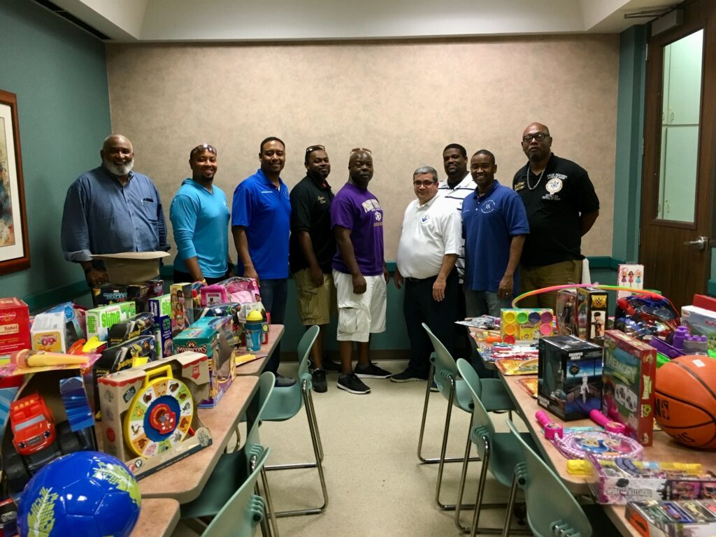 Xmas in July 2018 Toy Donation to Salvation Army Shelter - District Photo