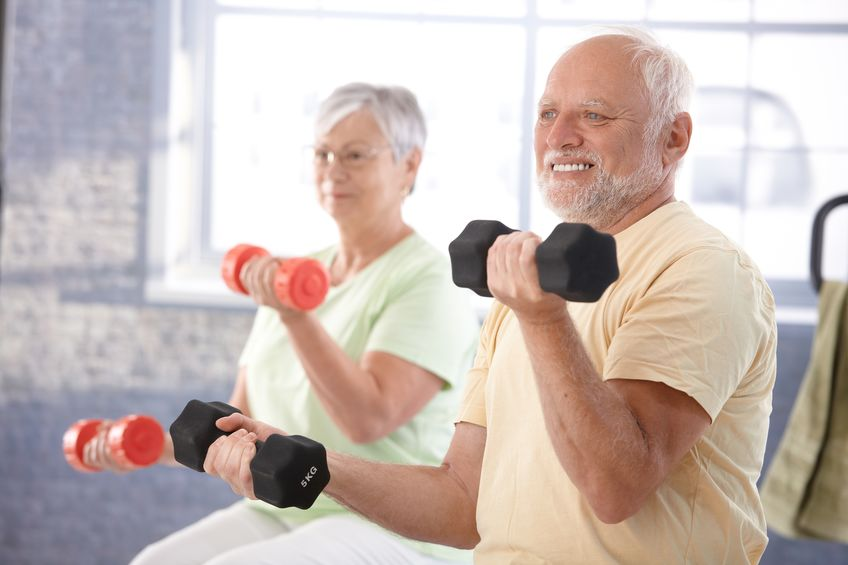 10389954 - senior people doing dumbbell exercises in the gym.