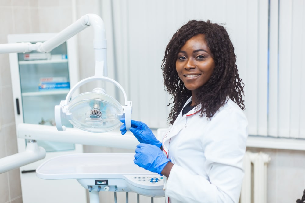 dental assistant smiling and posing in a dental office