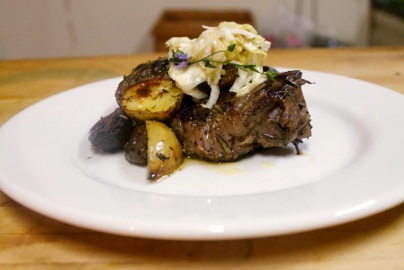 Lemon-Herb Marinated & Grilled Goat Porter House Chop w/ House Fennel Kraut and Brown Butter Roasted New Potato