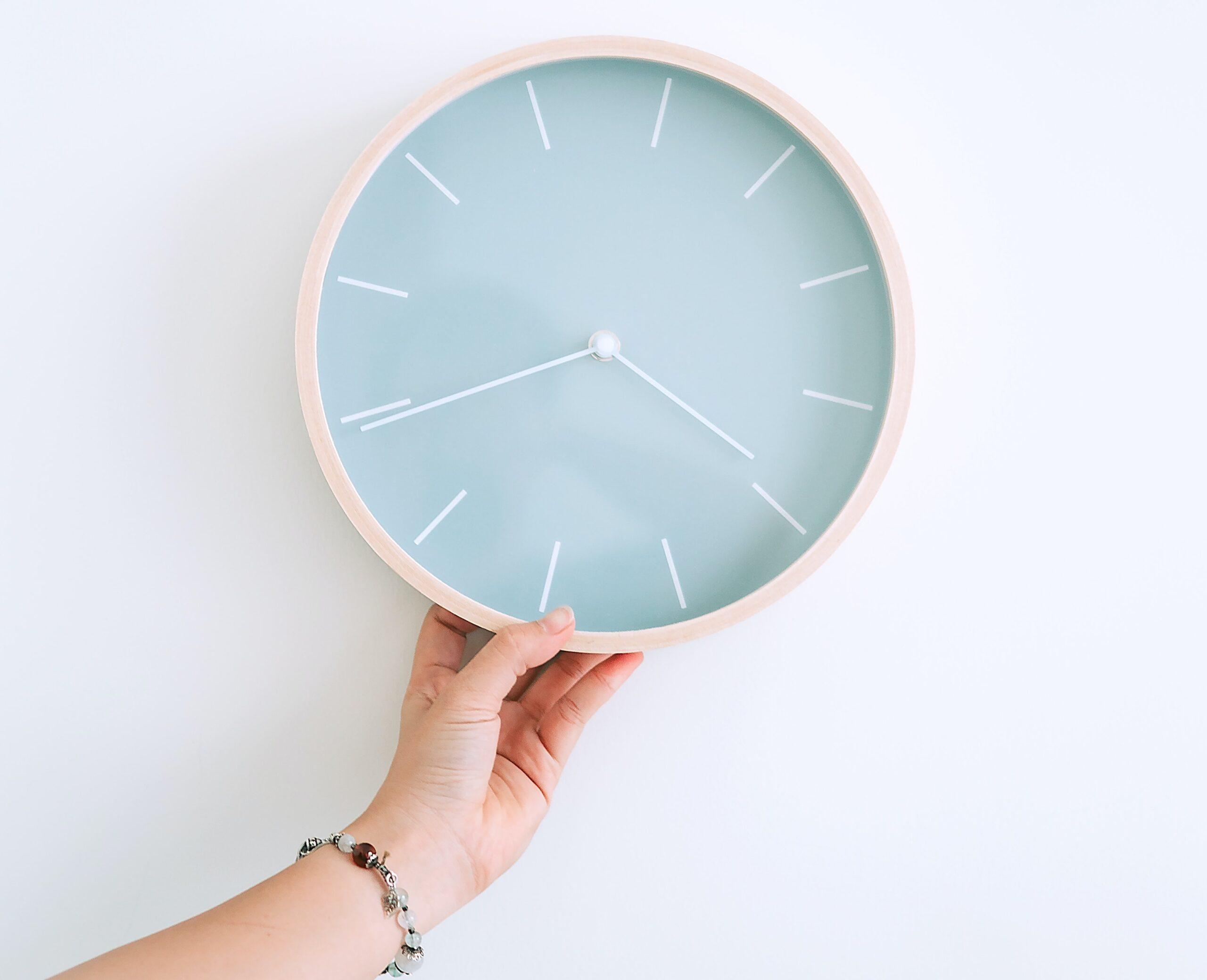 Girl Holding Clock