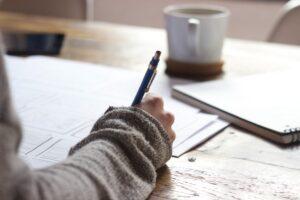 Girl writing with coffee