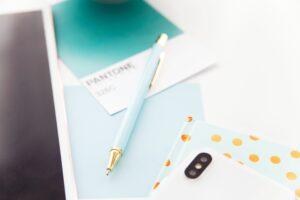pantone, book, pen, cellphone