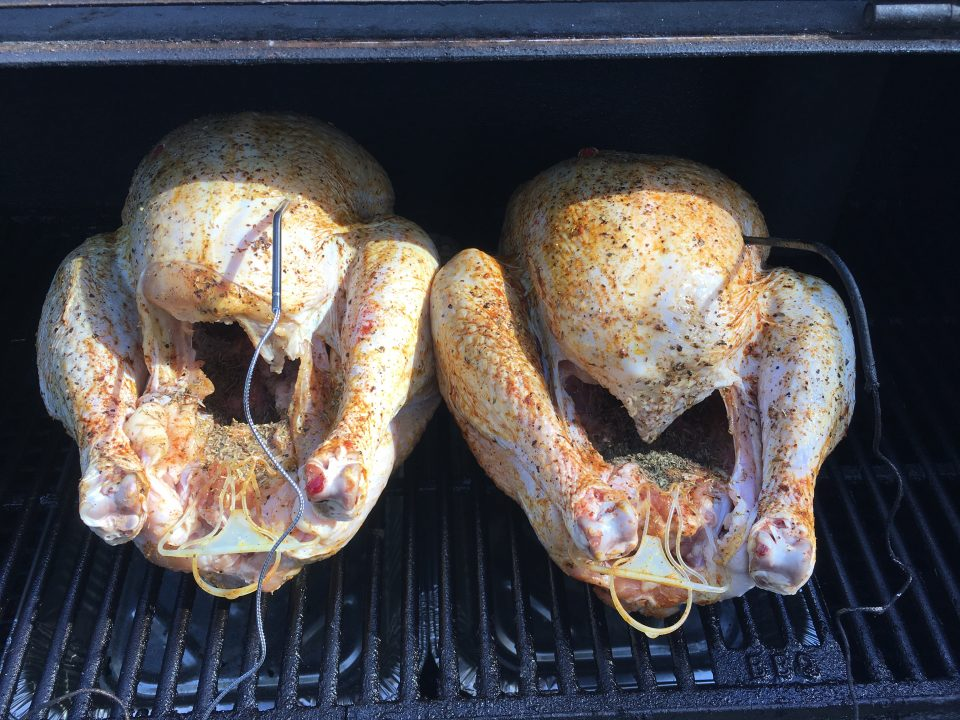 Turkey on an offset smoker with thermometer probes and water pans