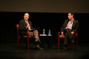 Two men are talking in Tony Kushner and Meeropol Talk Show