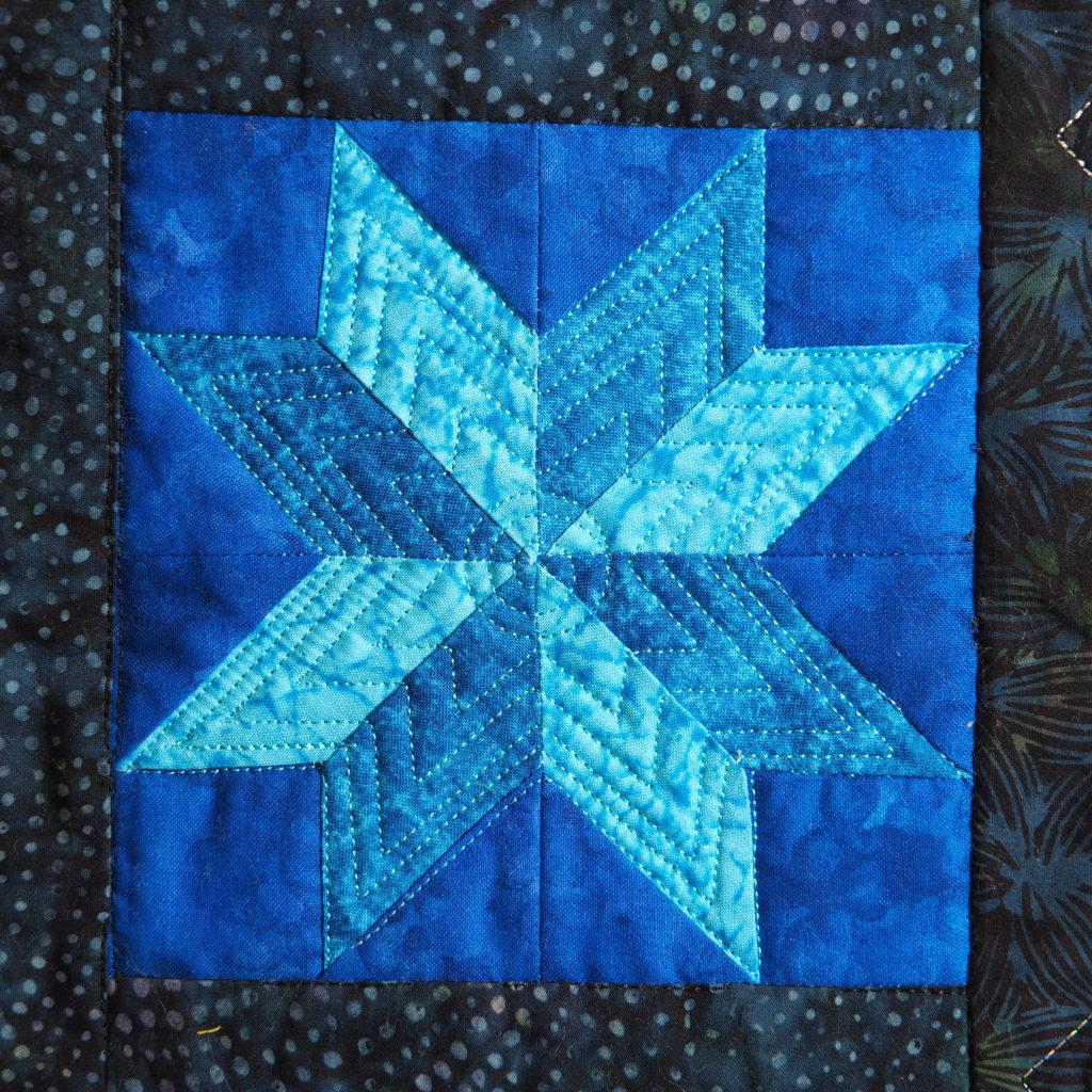 Quilt motif 8 pointed star Reverse echo quilting LeMoyne Star
