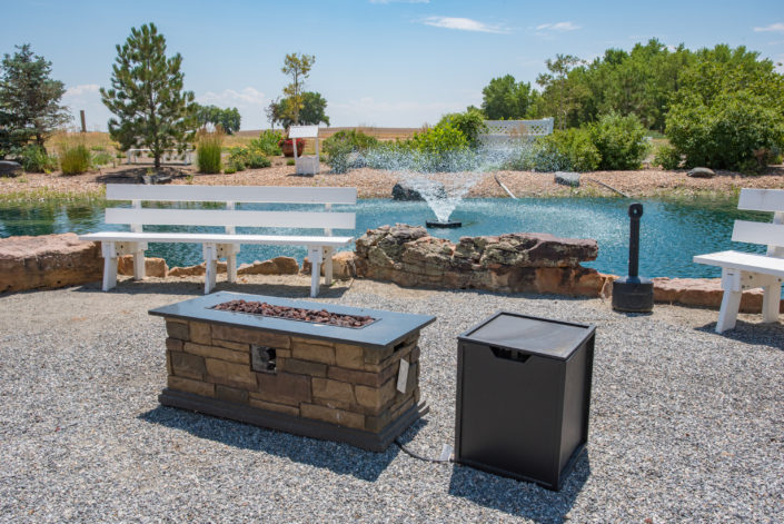 outside water feature with fire pit
