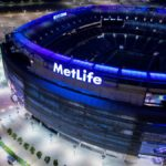 MetLife Stadium Solar Ring Project at night. Our 1400 custom modules have RGB LEDs below the glass. This creates a mood ring for the entire stadium. Immediately after ring was installed Hurricane Sandy arrived. No problem, even though the ring is 185' above ground level.