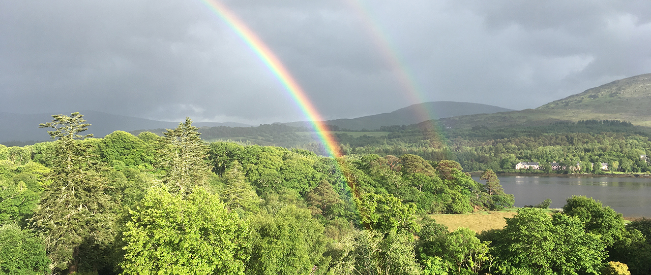 photo of a rainbow in the hills of Kenmare, Ireland.