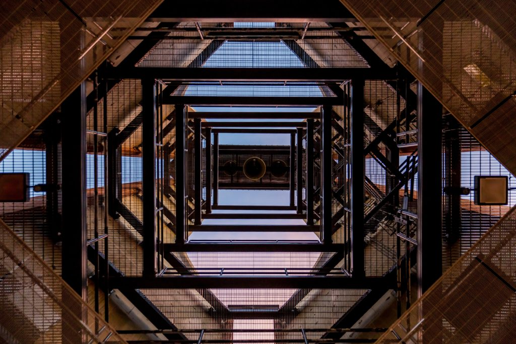 Photo looking upward into buidling scaffolding