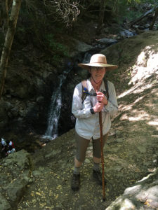 Author hiking next to waterfall
