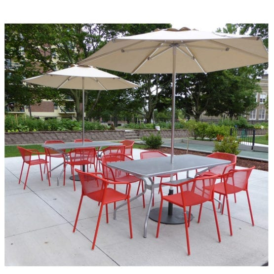 Two Aceray 803 48-inch long outdoor steel tables in aluminum finish on outdoor patio with red Lido-3 armchairs