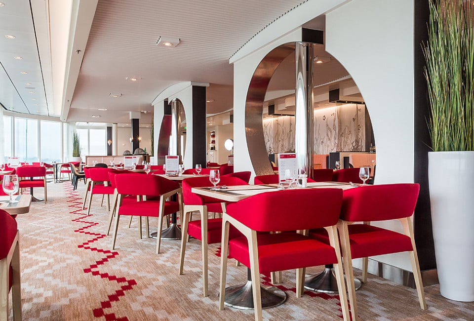 Gala-3 armchair in red upholstery brings this dining room to life
