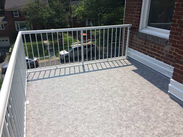 Flat roof transformation from Duradek and Durarail created a new leisure deck for the homeowners
