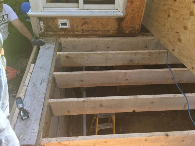 Porch renovation removing wood rot to joists