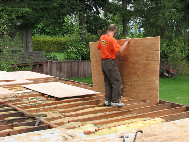 Building a deck adding plywood surface