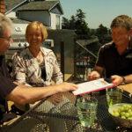 Contractor giving Duradek warranty to homeowners
