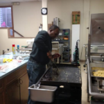 JW Myron Bell Sr. Frying Bacon For The Breakfast