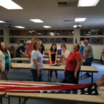 Folding the flags at the end 2016 July 4th.