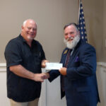 W.B. Hal Cottrell presenting a check to W.B. Steve Barchus, Nebraska Masonic Home Foundation Director