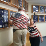 W.B. Wes Agar and Kim Hansen putting flags back in the display cases