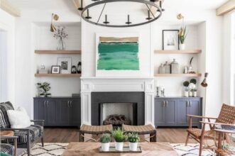 Matte black fixtures are popular in 2021. To keep your home from being dated down the line, bring in small doses of this trend and incorporate classic looks. This design by New South Home features a black chandelier and brass sconces, mixing the two finishes. (Laura Sumrak)