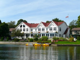 Waterfront view of main lodge at Glen House Resort, Ontario Sea Doo Lodgings
