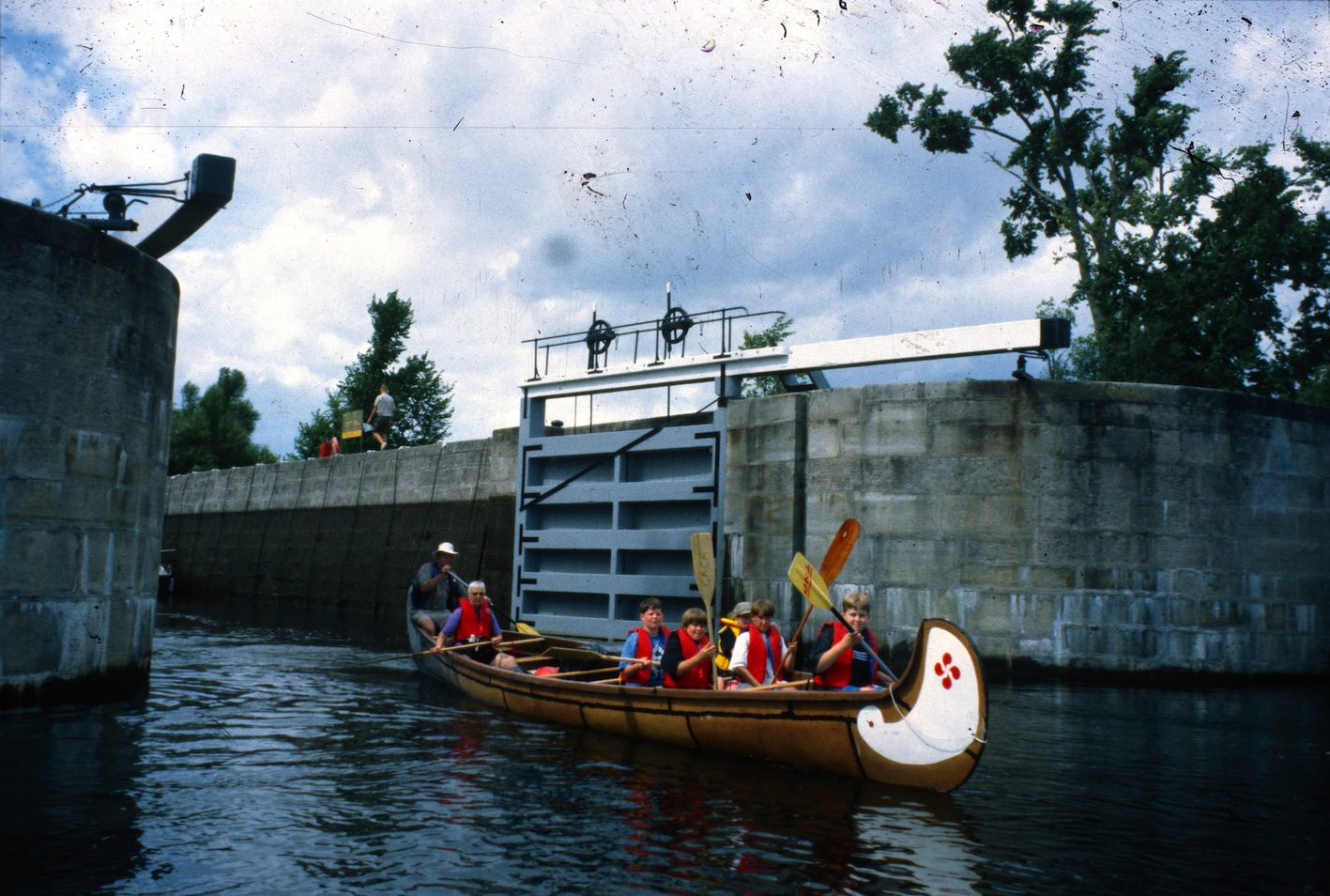 Young campers in war canoes on the Rideau Canal Sea Doo Tour