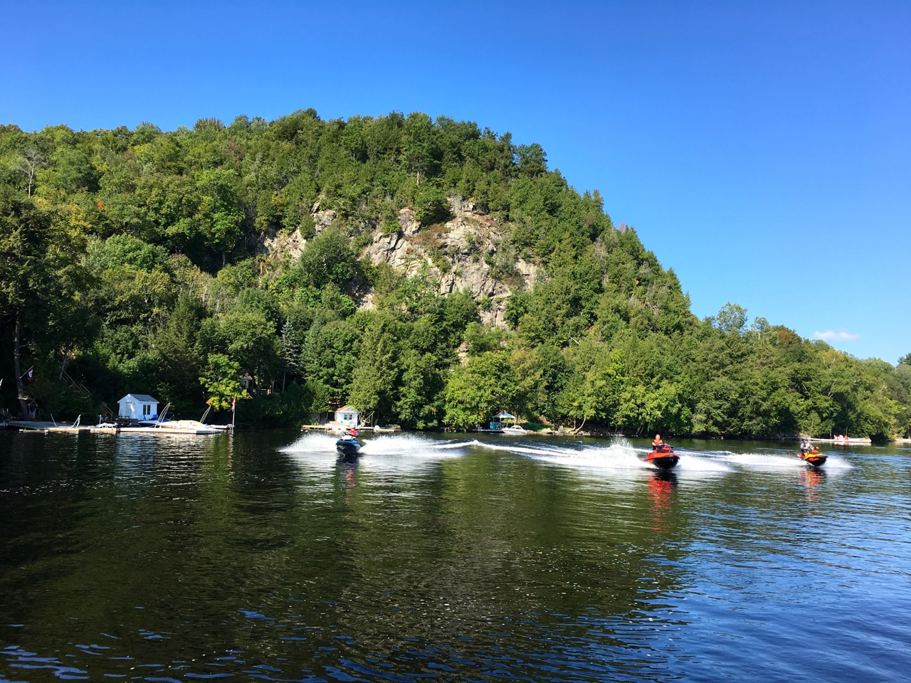 Riding past rock face on Fairy Lake during Muskoka fall Sea Doo tour