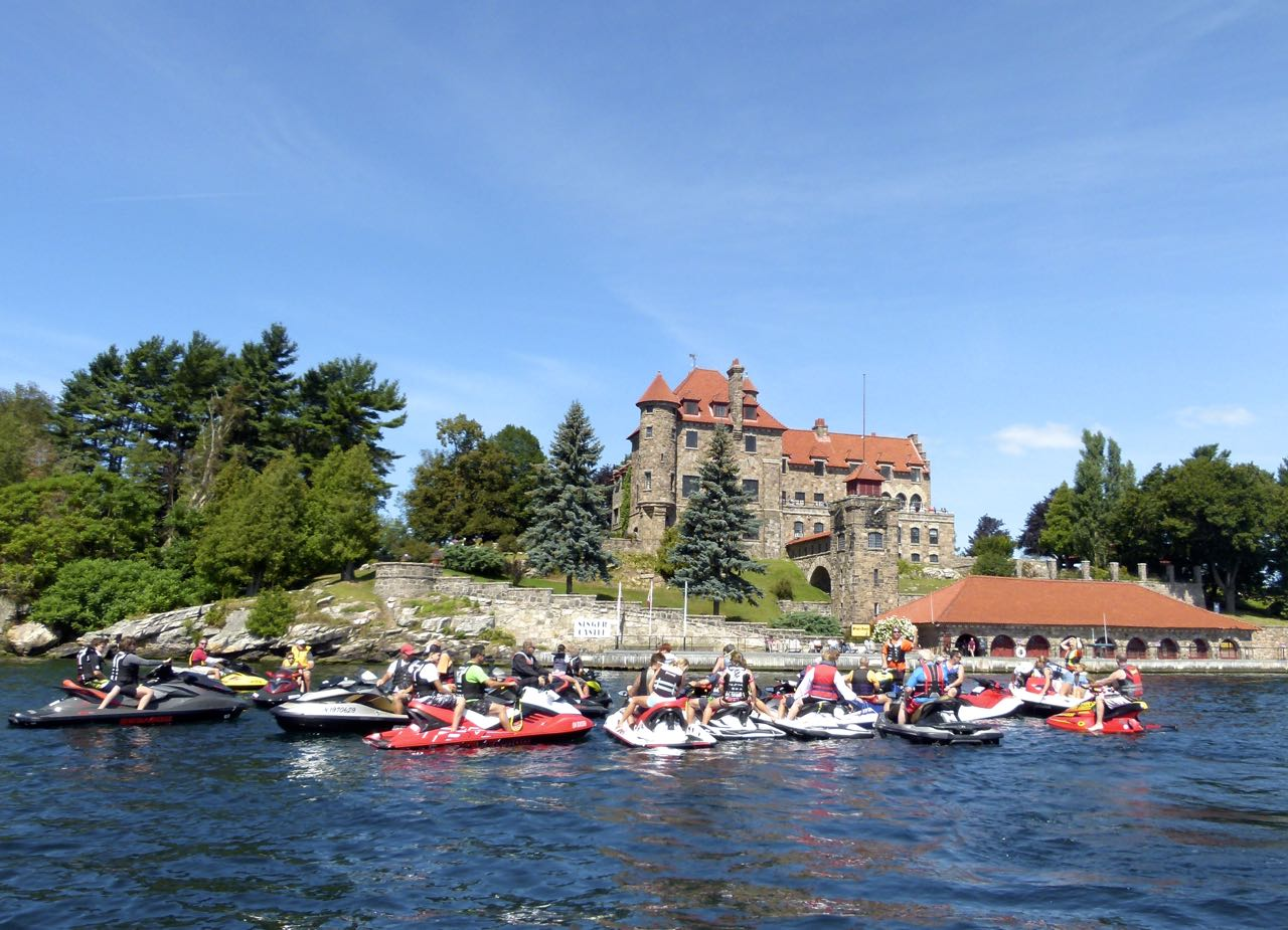 Large group riding participants in front of Singer Castle, 1000 Islands
