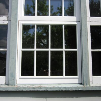Awning window with SLIP