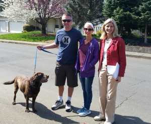 Vicki and couple with dog doorbelling 040216