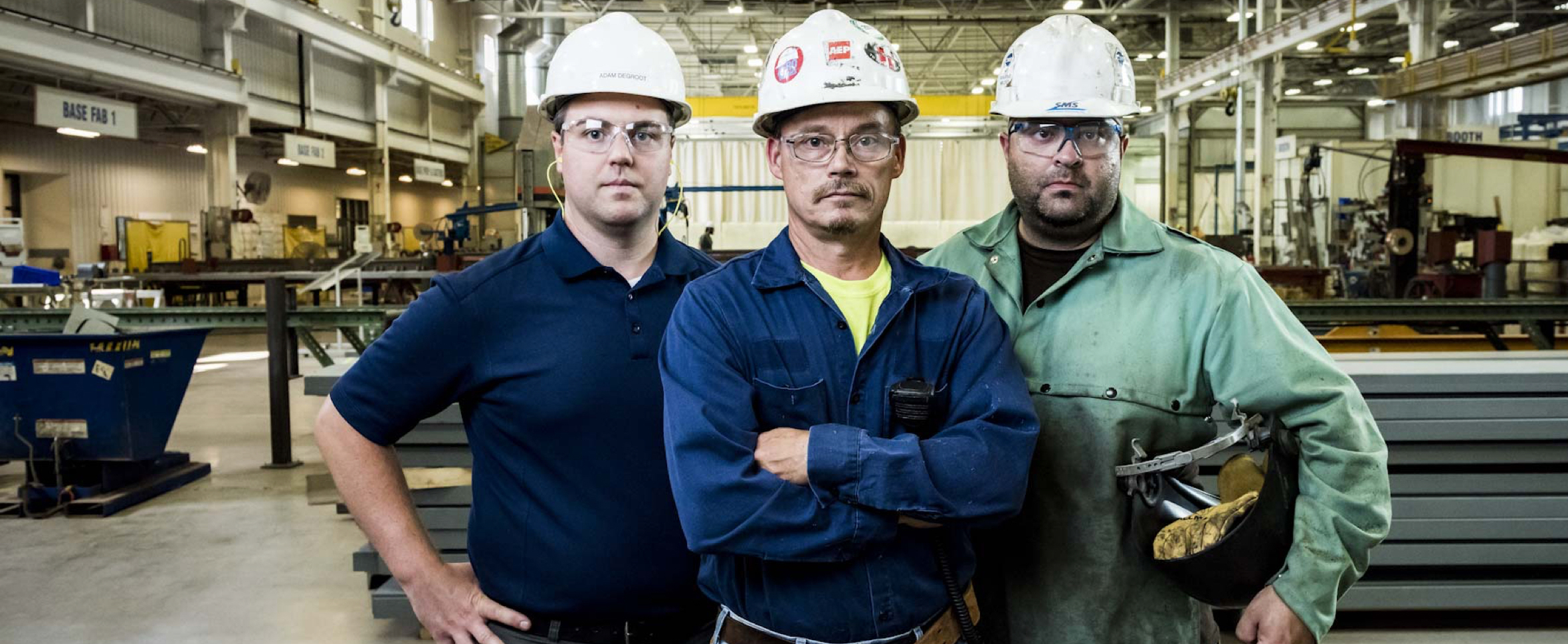 Integrity - Three strong workers proud of their hard work and dedication to getting the job done right