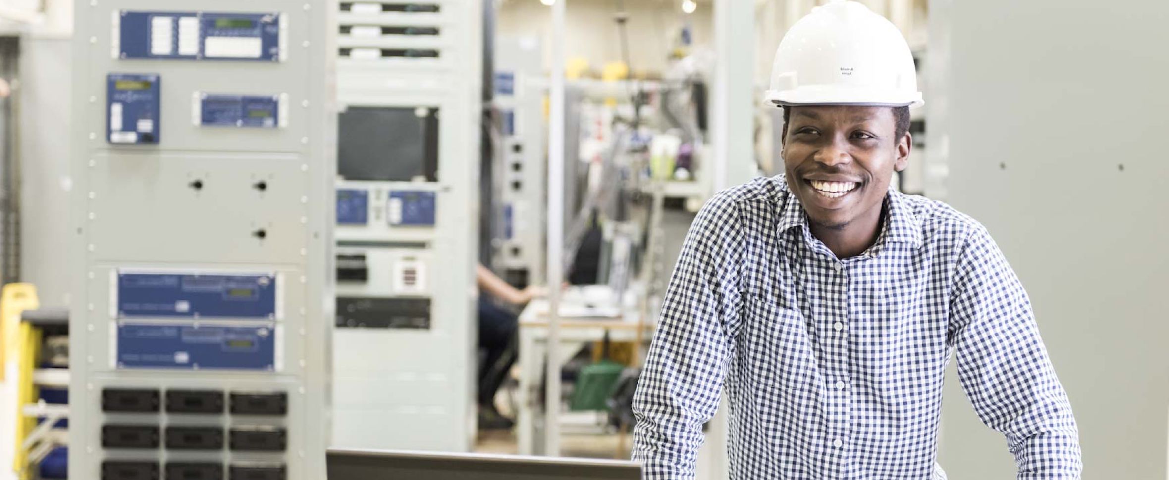 Positive Energy - Smiling engineer proud of his high-quality workmanship at Systems Control