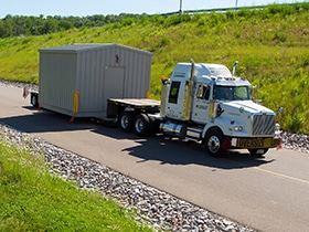 enclosure on flatbed truck