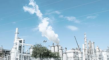 smokestacks on an oil refinery