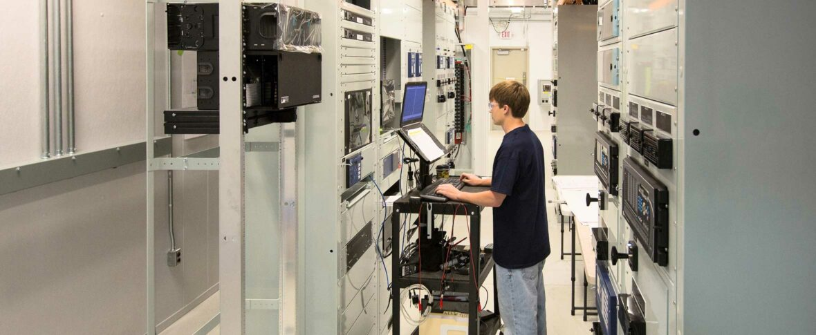 Man at a computer console testing equipment