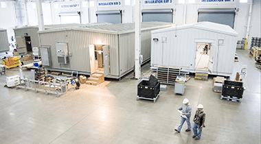 equipment enclosures in progress on factory floor