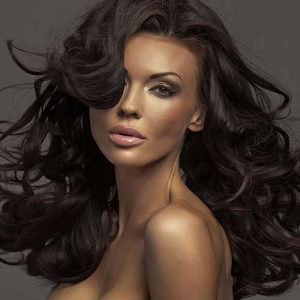 Beauty shot of a woman with soft wavy hair.