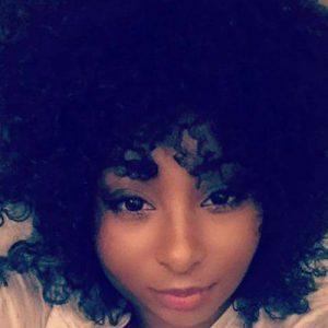 Self-portrait of a beautiful woman with kinky hair.