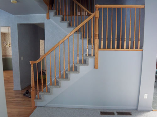 carpeted stairs before painting